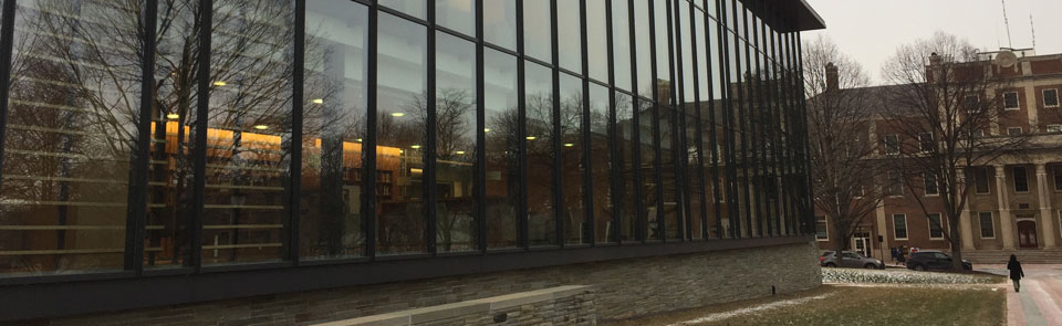 The glass-fronted windows of Skillman Library reflect the evening light.