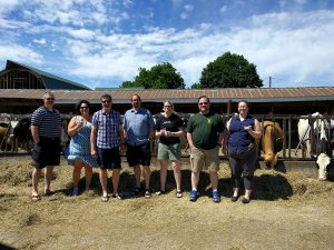 Group photo with cows at Cook's Farm