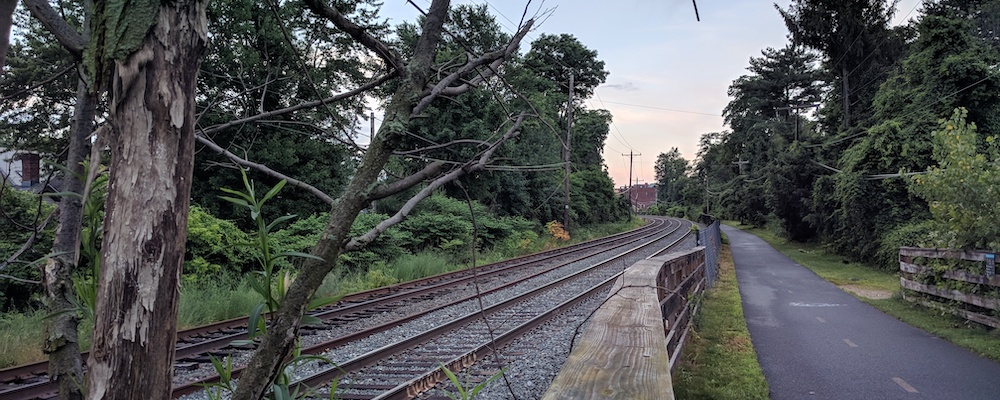 Train tracks and bike path head into the distance